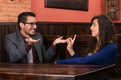 Young latin couple in a restaurant Royalty Free Stock Photography