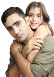 Young latin father carrying his daughte Stock Images