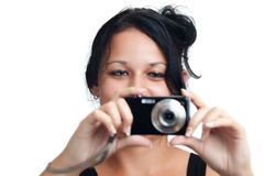 Young latin girl with a compact camera Stock Photos