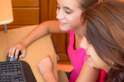 Young latin girl and her  mother working on a computer Royalty Free Stock Photo