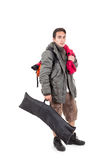 Young latin guy carrying backpack Royalty Free Stock Photos