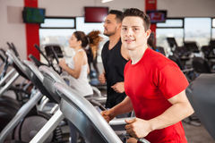 Young Latin guy doing some cardio in a gym Royalty Free Stock Images