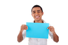 Young latin man, with blue  card in hand, smiling Royalty Free Stock Photography