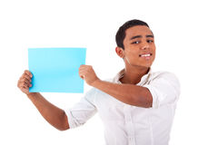 Young latin man, with blue  card in hand, smiling Stock Photo
