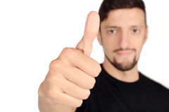 Young latin man doing ok gesture. Stock Image