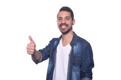 Young latin man doing ok gesture. Stock Photo