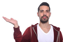 Young latin man holding something on the palm. Royalty Free Stock Photos