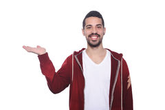Young latin man holding something on the palm. Attractive young latin man holding something on the palm.  white background Stock Images