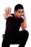 Young latin man, pensive, with his hand stop Stock Images