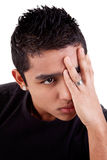 Young Latin Man, Pensive, With His Hand On Front Royalty Free Stock Photo
