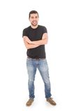 Young latin man posing with crossed arms. Isolated on white Royalty Free Stock Images
