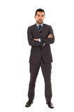 Young latin man standing wearing grey suit Stock Image