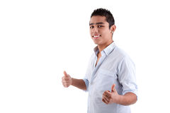 Young latin man with thumbs raised as a sign of ok Stock Photo