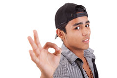 Young latin man with thumbs raised as a sign of ok Royalty Free Stock Image