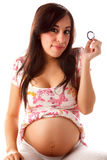 Young latin pregnant woman with condom Stock Photos