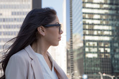 Young latin professional woman with glasses in the city Royalty Free Stock Photos
