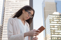 Young latin professional woman with glasses in the city Stock Photography