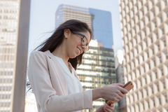Young latin professional woman with glasses in the city Stock Image