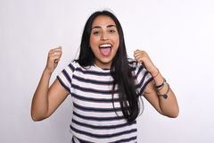 Young latin woman celebrating success Royalty Free Stock Photos