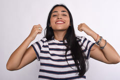 Young latin woman celebrating success Stock Images