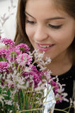 Young latin woman with flowers Stock Photography