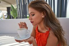 Young latin woman having coffee in lounge bar Royalty Free Stock Photo