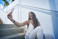 Young latin woman selfie photo smarphone Stock Image