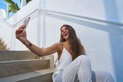 Young latin woman selfie photo smarphone Stock Photography