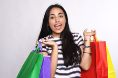 Young latin Woman with shopping bags Stock Image