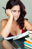 Young latin woman studying at home Royalty Free Stock Photos
