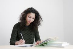 Young latin woman studying. In an empty room Royalty Free Stock Images