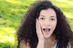 Young latin woman with surprised facial expression. Royalty Free Stock Photography