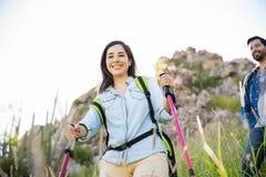 Attractive woman climbing a mountain Royalty Free Stock Photos