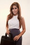 Young latina brunette woman. Holding briefcase Royalty Free Stock Image