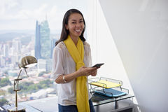 Young Latina Business Woman With Phone In Office 2 Stock Photo