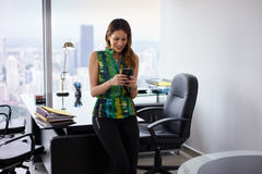 Young Latina Businesswoman With Phone In Modern Office Stock Images