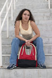 Young Latina Student with backpack on stairs Royalty Free Stock Photo