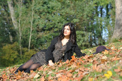 Young latina woman. In autumn stock photo