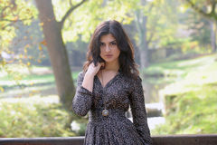 Young latina woman. In autumn royalty free stock photo