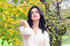 Young latina woman. In autumn stock photography