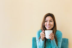Young latina woman drinking coffee stock images
