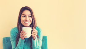 Young latina woman drinking coffee stock photography