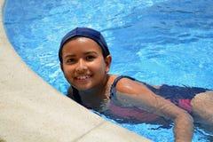 Young latinamerican girl in the swimming pool. Stock Photo