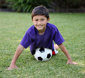 Young latino boy with soccer ball Stock Image