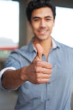 Young latino businessman holding thumbsup sign Royalty Free Stock Photo