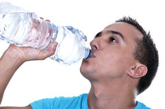 Young Latino drinking water. From a bottle Stock Images