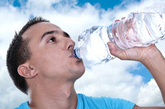 Young Latino drinking water Stock Photos