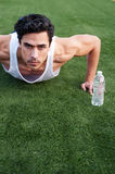 Young latino male athlete doing pushups Stock Photo