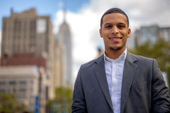 Young Latino man in city smile face Stock Photos