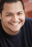 Young Latino man smiling Stock Images